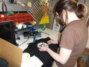 Applying vinyl to t-shirt