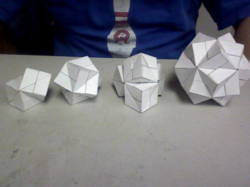Sonobe Constructs: From the left: conjoined cubes, stellated octahedron, some tetrahedral cube shape, stellated icosahedron